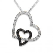 0.69ct. diamond pendant set with diamond in heart pendant